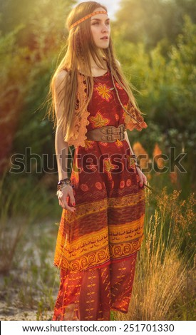 Girl in national dress on nature - stock photo