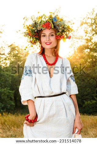 Girl in national ukrainian wreath - stock photo