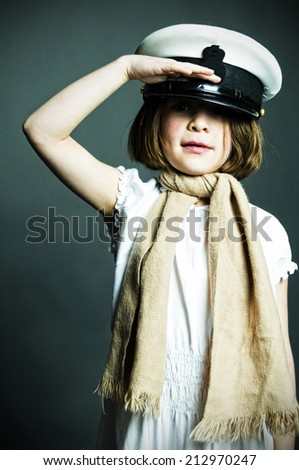 Girl in naval cap saluting