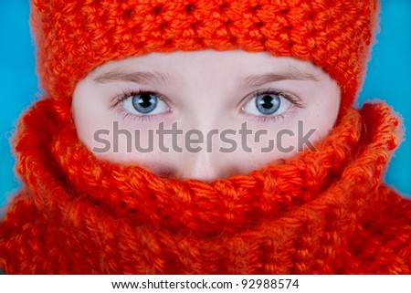 Girl in Orange Hat and Scarf - stock photo