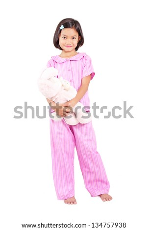 Girl in pajama hugging a teddy bear.Full body shot. Isolated in white background. - stock photo