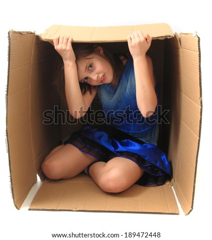 girl in paper box isolated on the white background - stock photo