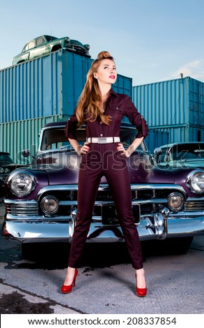 Girl in pin-up on a background of retro cars. parking  - stock photo