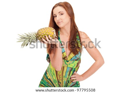 Girl in pineapple-like dress with pinapple in hands