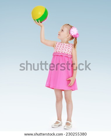 Girl in pink dress holding a ball.charming little girl - stock photo