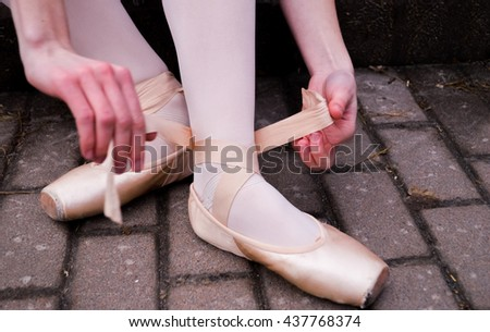 Girl in pointes.Beautiful ballet pose..ballerina in a tutu