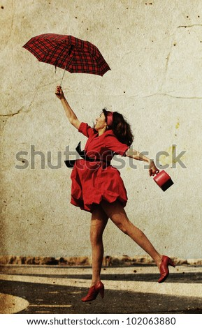 girl in red dress flies on a date. Photo in old image style. - stock photo