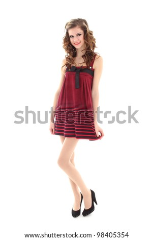 girl in red dress standing isolated over white background - stock photo