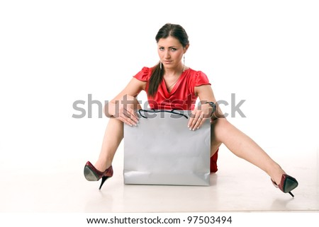 Girl in red dress with a bag