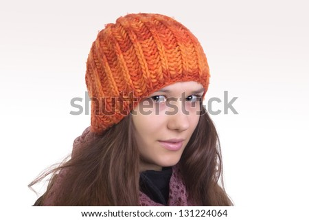 Girl in red knitted cap