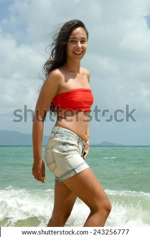 Girl in red on the beach