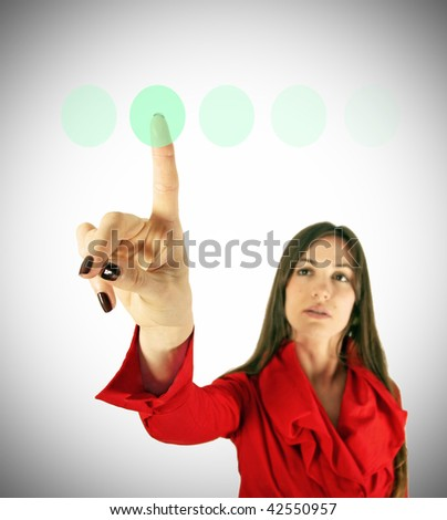 Girl in red touch virtual green button finger. Modern technology concept. Business concept.