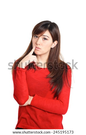 Girl in red with thinking hand gesture on white background