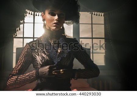 Girl in retro hat, lace blouse buttons on the chest - stock photo