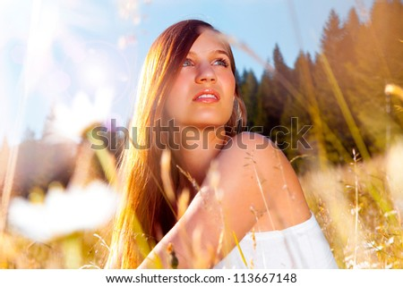 girl in romantic sunset in a meadow - stock photo