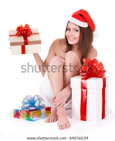 Girl in santa hat holding gift box. Isolated.
