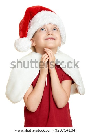 girl in santa hat on white isolated - stock photo