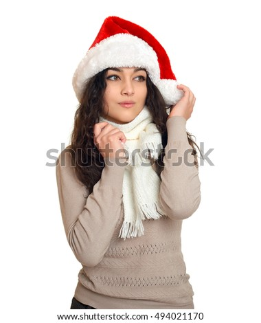 girl in santa hat portrait, posing on white background, christmas holiday concept, happy and emotions
