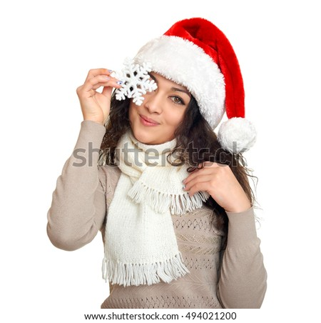 girl in santa hat portrait with snowflake posing on white background, christmas holiday concept, happy and emotions
