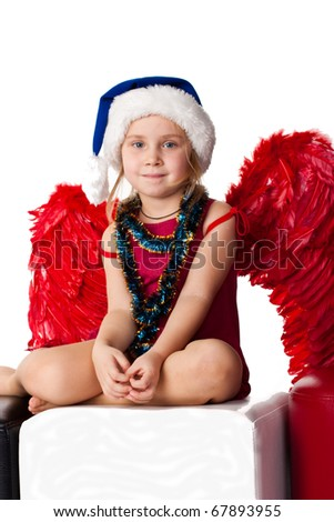 Girl in Santa's blue hat and tinsel with red angel's wings  isolated on white