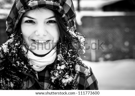 Girl in snow laughing - stock photo