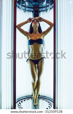 Girl in Solarium - stock photo