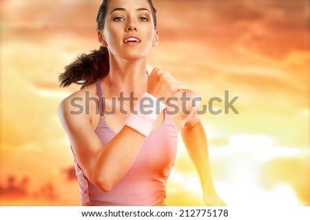 girl in sport on the sunset background - stock photo