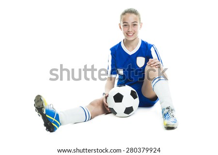 girl in sport wear with football isolated on white background - stock photo