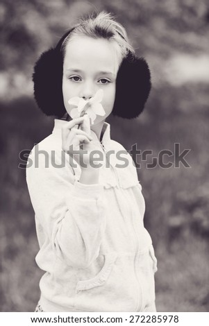 girl in spring time with yellow flower - stock photo