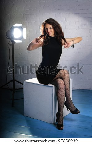 Girl in studio during the photo shoot