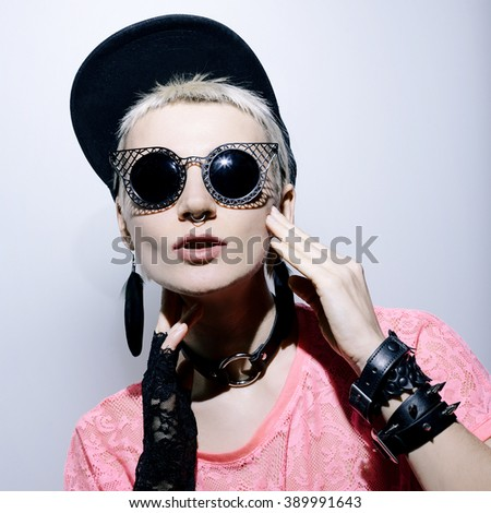 Girl in stylish black accessories. Fashion glamorous style
