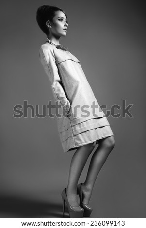 Girl in stylish clothes. Beauty, fashion, original poses. Picture taken in a studio full-length.