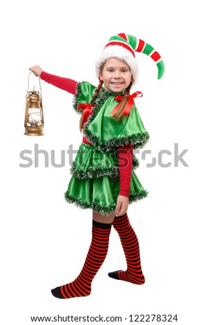 Girl in suit of Christmas elf with oil lamp. Isolated on a white background - stock photo