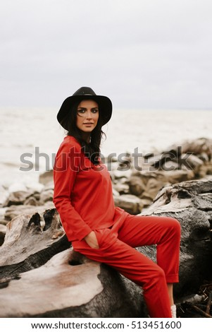 girl in suit on the shore