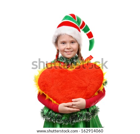 Girl in suit Santa's elf holds heart . Isolated on the white background - stock photo