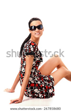 Girl in sun glasses looks attentively and strictly. - stock photo