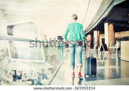 Girl in the airport. Washed out photo look. - stock photo