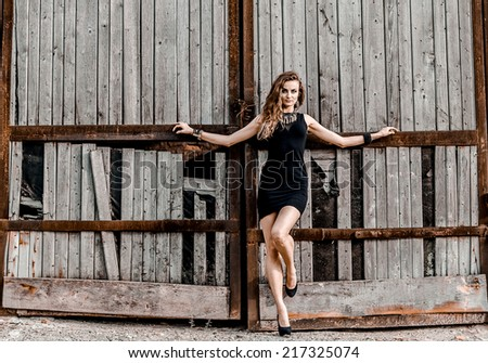 Girl in the black dress - stock photo