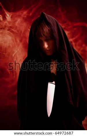 Girl in the black sheet with the knife