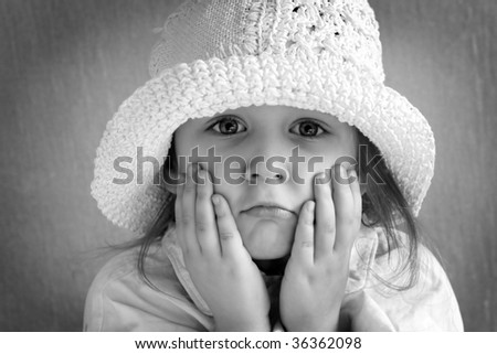 girl in the cap closed face hands - stock photo