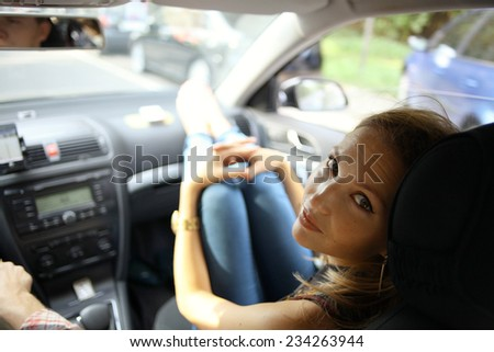 girl in the car on the passenger seat