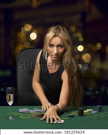 girl in the casino playing poker, bokeh - stock photo
