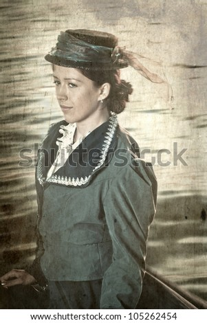 Girl in the clothes in the retro style near the river Neva in St.Petesburg, Russia. Vintage style, grungy effect. - stock photo