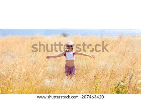girl in the field - stock photo