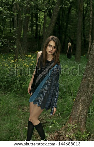 girl in the green woods with dress made of ties