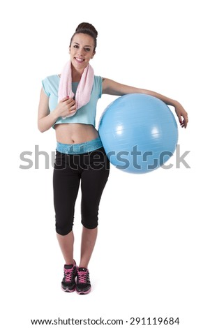 girl in the gym with ball and towel