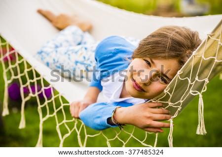 Girl in the hammock - stock photo