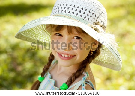 Girl in the hat and dress smiling