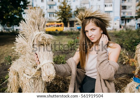 Girl in the hay. Hay, straw.