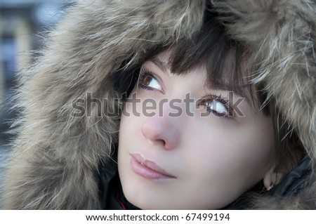 girl in the hood with fur - stock photo